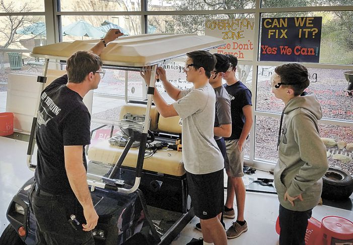 Booth STEM students refurbish golf carts