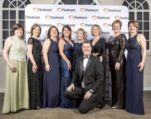 The Piedmont Fayette Gala Committee are, from left, Pat Cook, Amy Burnett, Gina Wilson, Anne Williams, Debbie Britt, Vickie Turner, Dr. Angela Swayne, Dr. Elizabeth Killebrew and gala auctioneer, Stephen Walker. Photo/Joey Appie Photography.