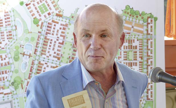 Dan Cathy in front of a map of Pinewood Forrest. Photo/Ben Nelms.