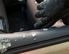 Thieves bust into dozen vehicles, steal one with motor left running