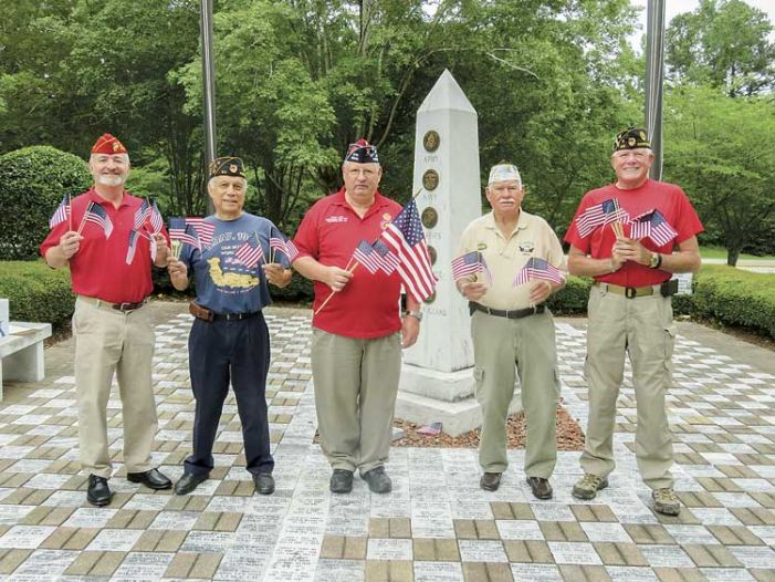 Veterans ready with American flags