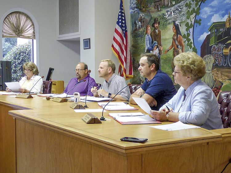 The Tyrone town Council on July 20 unanimously approved the development plan and rezoning for Founders Studios on Ga. Highway 74. Pictured, from left, are council members Gloria Furr and Ken Matthews, Mayor Eric Dial, and council members Ryan Housley and Linda Howard. Photo/Ben Nelms.