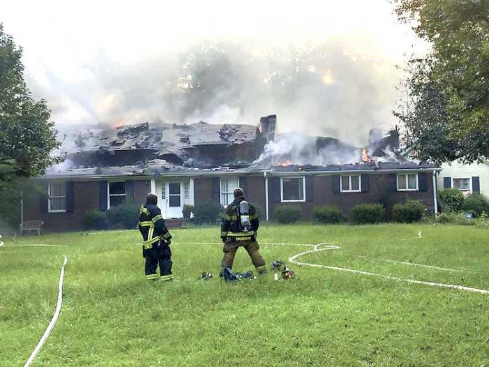 Attempt to burn out bees burns down Fayetteville house
