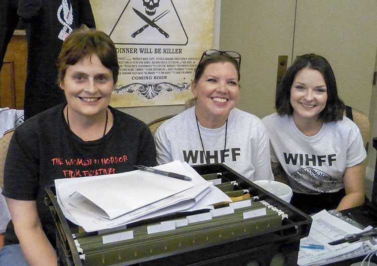 From left, volunteers at the festival included Susan Boone, festival coordinator, who lives in Senoia. She worked as a criminal prosecutor for over 20 years before starting a second career in film as a script supervisor. Nina Ackerman of McDonough graduated from Clayton State in Film Production. Gabby Caldwell, from Atlanta, is in video production. Photo/Bonnie Helander.