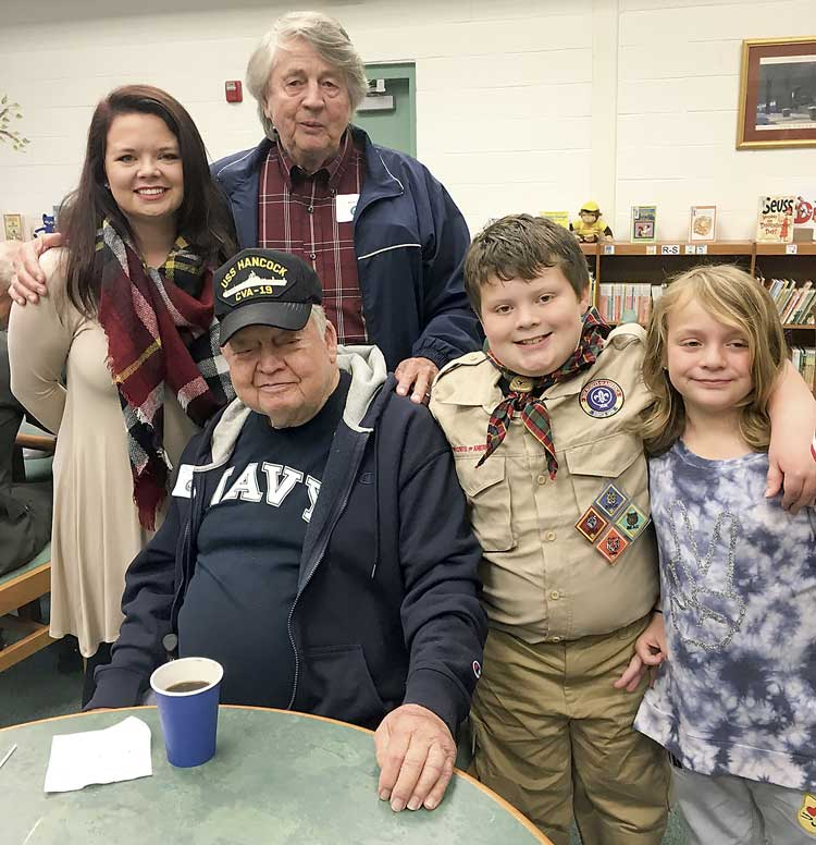 Below, from left, Jessica Faulkner, Alvin Parker, Dale Andrews, Carson and Caroline Moses pose for a photo in the school library. Photo/Jessica Faulkner.