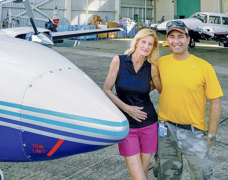 news_01-24-18_Puerto-Rico-mercy-flight_Holly-and-I-in-front-of-Arlet-Aviation.--They-offered-their-hangar-for-free-storage-of-supplies