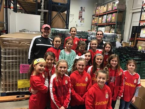 Soccer girls lend a hand