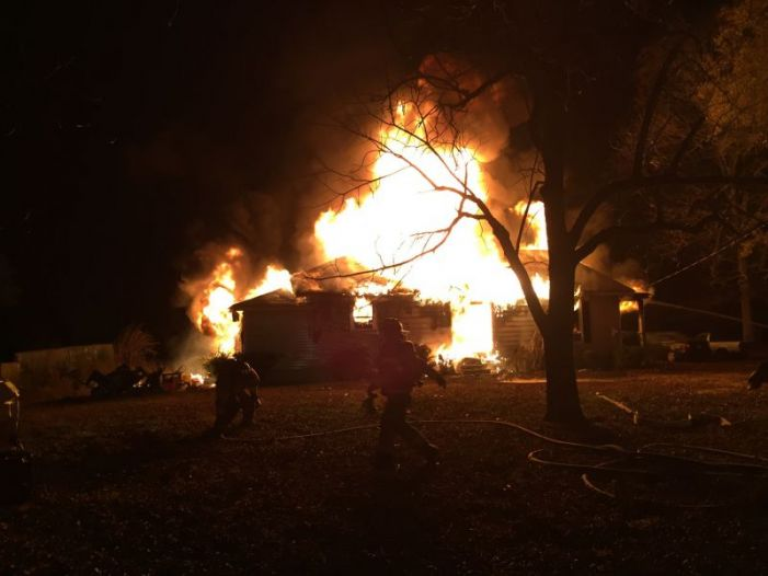 Home destroyed in fire, residents safe
