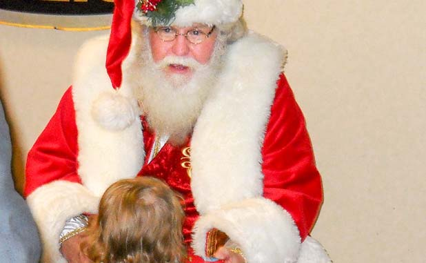 Fayetteville cops serve as Santa for needy children