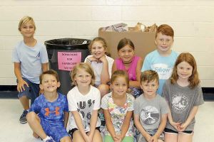 Students, staff and parents from Braelinn Elementary School are collecting disaster relief supplies to help the relief efforts in Texas. Back row, L-R, Jackson Schwieger, Ella Kinsinger, Perry Schwieger, Drew Laughlin. Front row, L-R, Drew Kinsinger, Katie Kinsinger, Elllie Schwieger, Ryan Laughlin, Lydia Laughlin. Photo/Braelinn Elementary School.