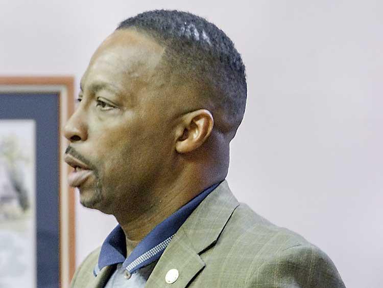 Rep. Derrick Jackson (D-Tyrone)speaks at the council meeting. Photo/Ben Nelms.