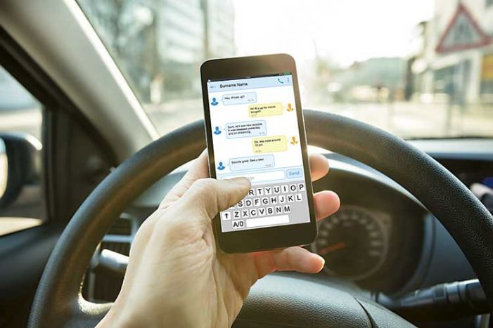 As of July 1, a new crime: Driving while holding cellphone