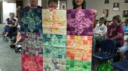 Southern Crescent Quilters Guild donates quilt to the Harvest for Hope Real Life gala