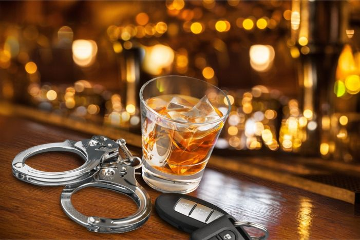 After leaving restaurant, woman charged with numerous violations